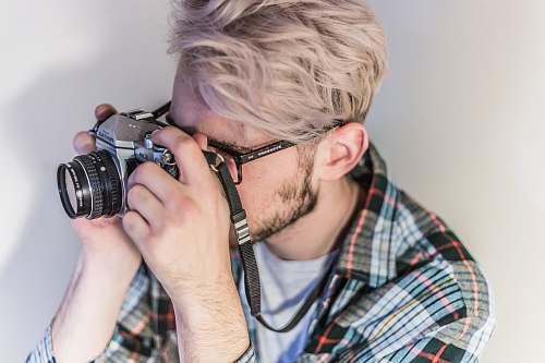 person man taking photo using camera human