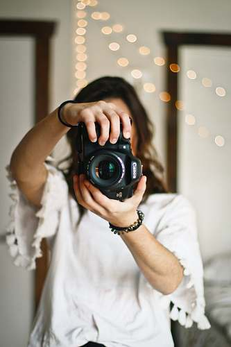 photo person woman holding black DSLR camera human free for commercial use images