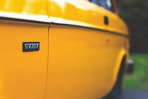 photo automobile close up photography of yellow Volvo car yellow free for commercial use images