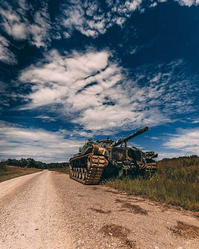 gravel grey battle tank on road during daytime road