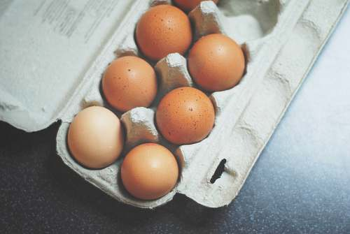grey seven brown eggs on tray egg