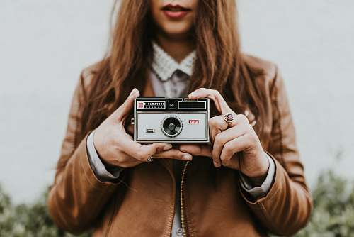 person woman holding camera photography