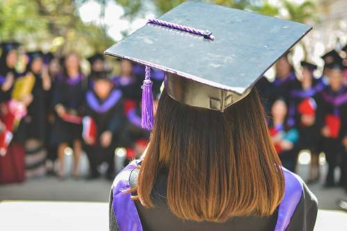 person woman wearing academic cap and dress selective focus photography graduation