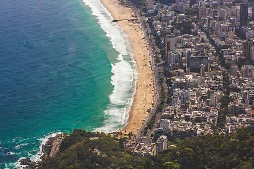 nature aerial view of city and seashore outdoors