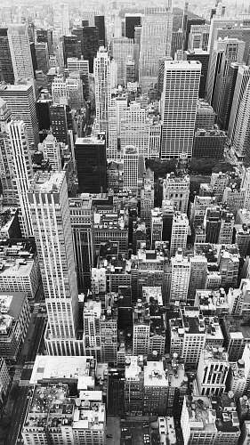 outdoors grayscale photography of city buildings black-and-white