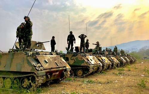 tank soldiers on top of battle tanks army