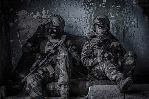 clothing two officers sitting on sofa apparel
