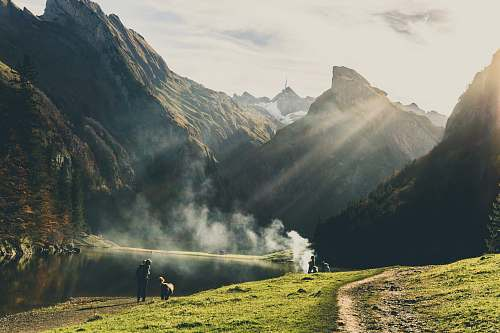 switzerland group of people making smoke during daytime mountain
