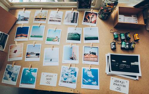 polaroid assorted photos on beige wooden table decoration