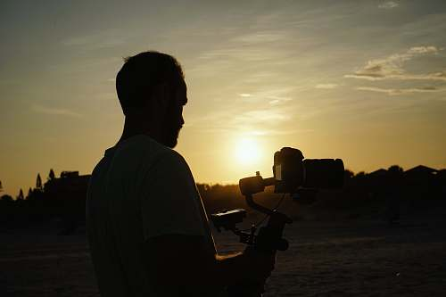 photo human man holding camera light free for commercial use images