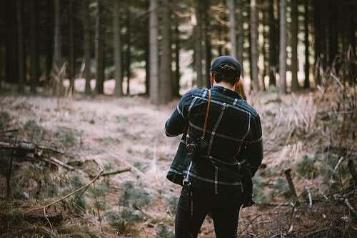 vegetation man standing in forest forest