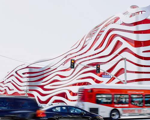 bus red and white building transportation