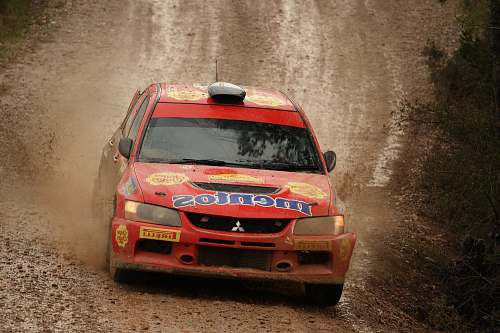 photo transportation red Mitsubishi Lancer on road offroad free for commercial use images