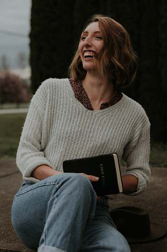 apparel smiling woman wearing white knit sweater sweater
