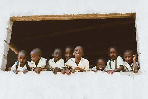 person children standing in front of window liberia