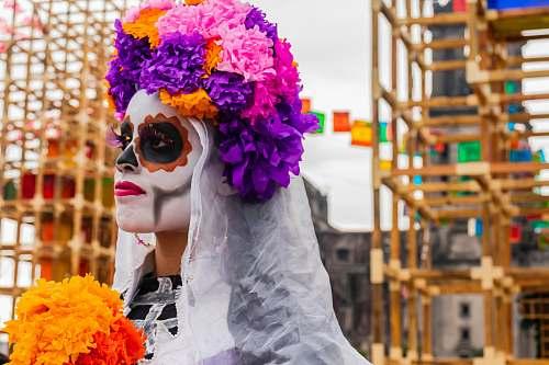 person person wearing flowers near scaffolding cdmx