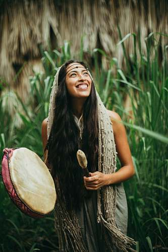 person woman playing drum during daytime close-up photography drum