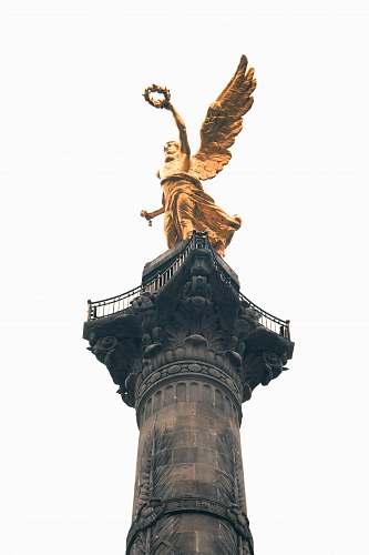 sculpture brass-color statue column