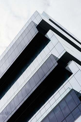 office building low angle photo of buildings architecture