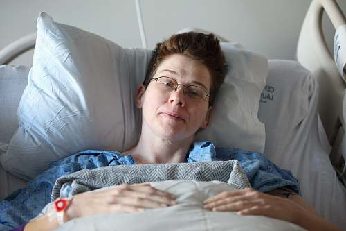 photo  woman lying on bed  free for commercial use images