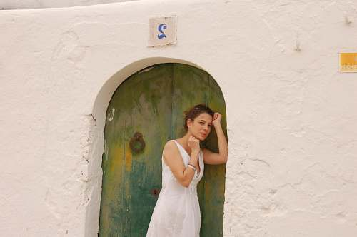 photo clothing woman in white dress leaning on green and blue door during daytime ] evening dress free for commercial use images