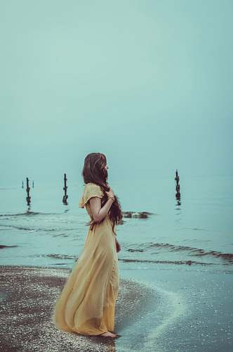 clothing woman standing on shore evening dress