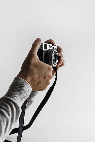 photo human person holding gray and black camera person free for commercial use images