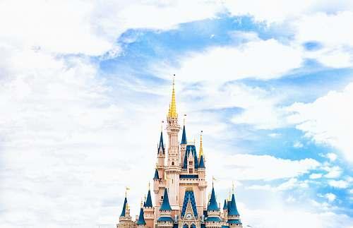 architecture landscape photography of Walt Disney castle under cloudy sky disney