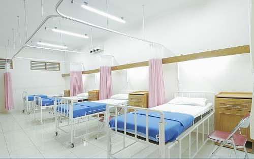 furniture empty hospital bed inside room healthcare