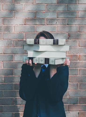 photo apparel person holding pile of books near face grey free for commercial use images