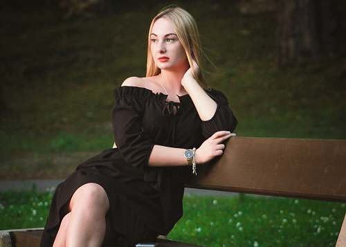 photo apparel woman in black off-shoulder dress sitting on wooden bench evening dress free for commercial use images