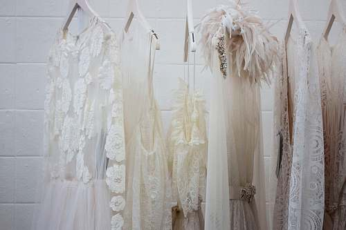 clothes six women's white dresses hanging on hangers wedding