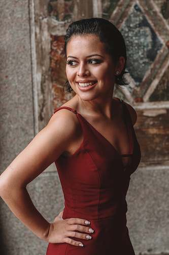 photo clothing smiling woman wearing red V-neck sleeveless dress evening dress free for commercial use images