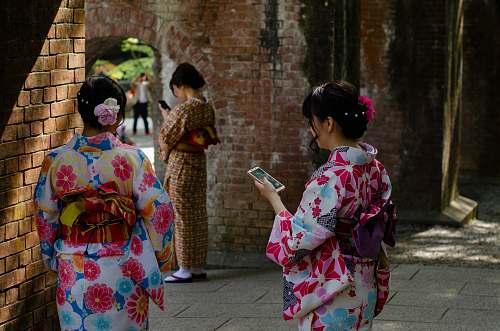 apparel three women wearing kimono dresses during daytime clothing