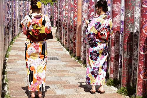 apparel two women wearing floral traditional dresses clothing