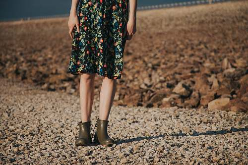 evening dress woman standing on gravel wearing floral dress person