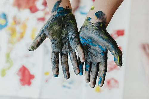 kid person hands with green paint blossom