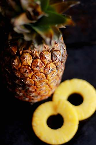 photo fruit brown pineapple fruit beside slice fruits pineapple free for commercial use images