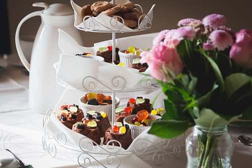 cake cupcakes on white metal cupcake stand dessert