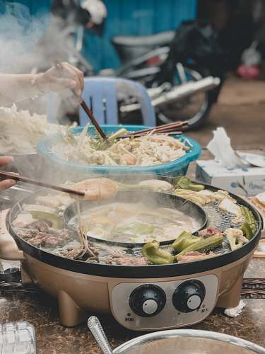 meal person cooking vegetables dish