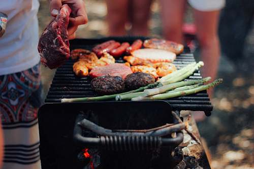 photo bbq person grilling meat people free for commercial use images