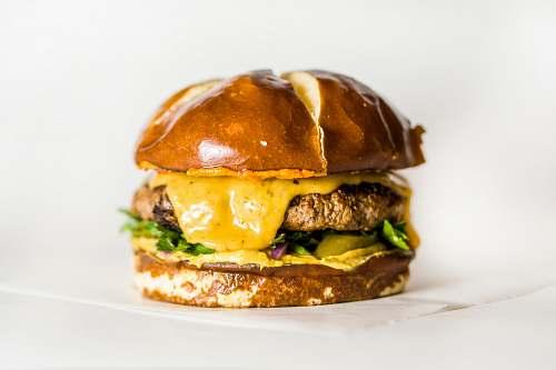 burger shallow focus photo of hamburger pretzel
