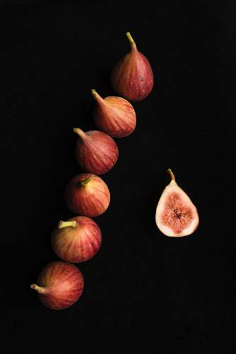 fruit six onions on black surface fig