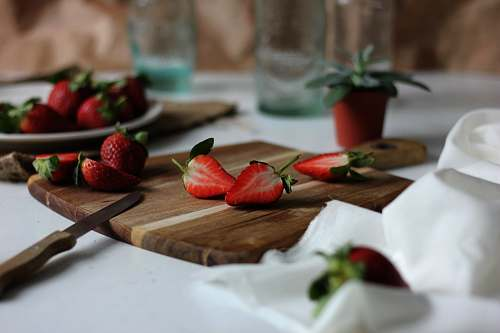 fruit sliced strawberries on chopping board strawberry