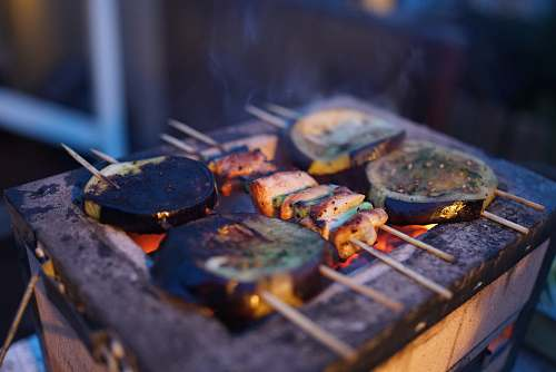 bbq three assorted barbeques on black grill skewers