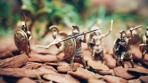 toy grey metal knights figurines during daytime bronze