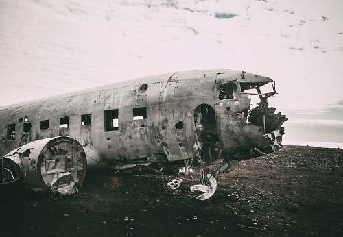 transportation grayscale photo of abandoned airliner in open field army