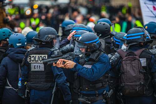 clothing blue and black uniformed police on street apparel