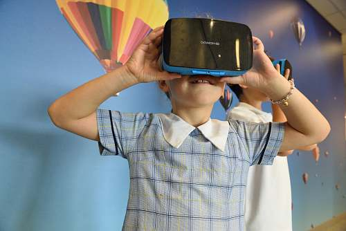 person boys using blue and black virtual reality headset primary school