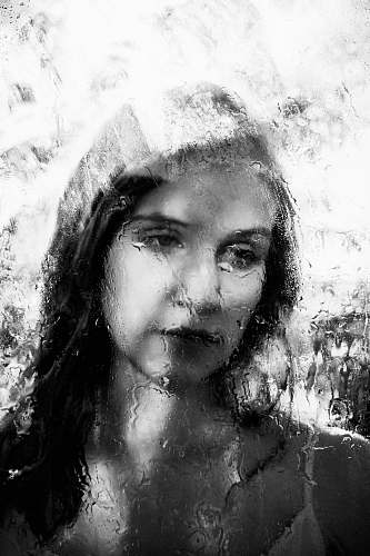 face grayscale photo of woman painting black-and-white